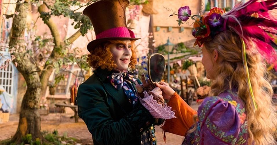 johnny-depp-e-mia-wasikowska-em-cena-do-filme-alice-atraves-do-espelho-dirigido-por-james-bobin-1459286419746_956x500